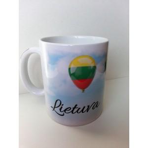 Dekoruotas puodelis baltu vidumi