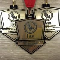 Medaliai graviruoti is organinio stiklo
